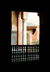 Inside a palace in marrakech (Federisco) Tags: morocco marrakech palace tiles earth wall pillar doorway window door opening fence