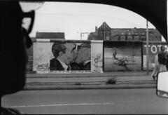 Berlin Wall, 1992 (jdunlevy) Tags: blackandwhite bw streetart berlin love film window wall 35mm kreuzberg germany painting deutschland kiss europa europe driving minolta kunst paintings sc