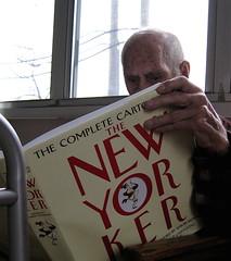 looking at his Christmas gift - by Susan NYC