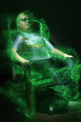 Electrocution (cszar) Tags: longexposure 15fav selfportrait lightpainting green me sunglasses topv111 1025fav 510fav myself cool chair topv555 topv333 nikon saveme inho d70 deleteme10 topv999 led spooky loveit 2550fav personalfavorite topv777 nikkor adidas lightinmotion fibreoptic