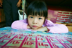 bored by the alphabet - asia girl travel thailand child alphabet pink bangkok table phitar 2006 bored