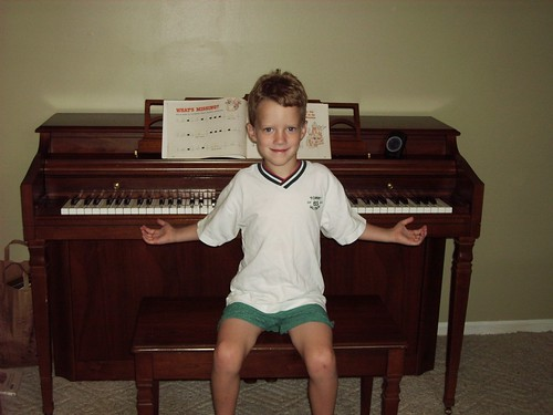 Kyle and our new (to us) piano, Jan 2006