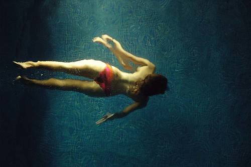 Girl in Bikini Underwater at Night