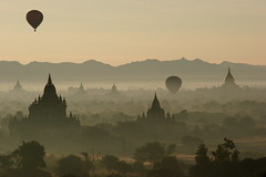sunrise over bagan (David Haberlah) Tags: sunrise pagoda bravo savedbythedeletemegroup burma stupa accepted1of100 balloon interestingness1 saveme10 myanmar oneyear birma bagan fivestarsgallery refreshedphoto n321fave bratanesque