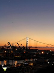 Port of call (Gurugo) Tags: bridge sunset portugal port lafotodelasemana albaluminis lisboa lisbon eps1 votadaconeps eps2 tejo ponte25deabril tagus lfscontraluces