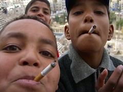 Kids smoking in the Roman Theatre in Amman (@fotochap) Tags: world travel loss kids youth cat children death marketing topv555 ruins sad roman mosaic topv999 amman young cancer middleeast charles tourist smoking jordan charlie topv5555 arab british topv777 topv11111 topv3333 brand tobacco antismoking jerash jordanian aqaba nicotine fume bedouin corruption mortality fumer karak carcinogen carcinogenic tyack topv33333 wwwcharlietyackcom charlietyack charlestyack childrensmoking