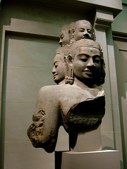 cambodia - angkor statue (Xuan Che) Tags: 2005 park travel winter sculpture newyork history museum asian cambodia december centralpark manhattan buddhism gods angkor canonixus400 themet