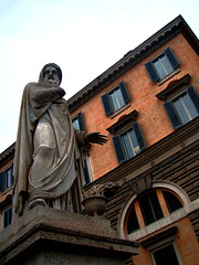 Theories of Hand Warming: Tested. (Trapac) Tags: blue windows winter italy sculpture orange man rome roma buildings italia hand flame torch shutters cloak marble filmgrain piazzadelpopolo
