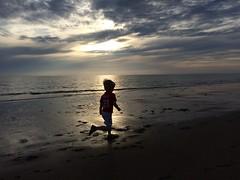 Beach runner (he really loves it  ) (Roel) Tags: light sea sky beach netherlands clouds strand nederland running zee runner rennen hardlopen silhouet