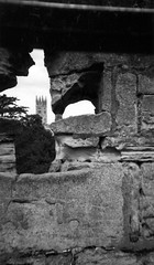 Warwick Castle View from a Window (Jae at Wits End) Tags: uk england blackandwhite bw white black building tower castle english church window monochrome architecture outside blackwhite ancient ruins europe exterior cathedral unitedkingdom outdoor decay ruin landmark tourist structure worn weathered opening british portal crumble warwick attraction eroded