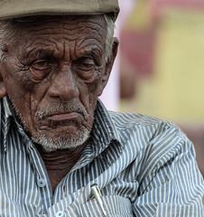 We all seek for   by: Natan Zach (ybiberman) Tags: old portrait india man hat pen candid streetphotography varanasi wrinkles parker