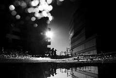 walk this way (maekke) Tags: zürich hardbrücke primetower kreis5 puddlegram reflection bokeh fujifilm x100t streetphotography man silhouette urban architecture pointofview pov 2016 bw noiretblanc 35mm