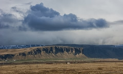 micro climate Icelandic style ;) (lunaryuna) Tags: iceland southiceland kirkjujabaerklaustur landscape sky clouds cloudscape weather rain microclimate mountainrange spring season seasonalchange weathermood panoramicviews lunaryuna