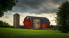 Barn Stormin' (David Colombo Photography) Tags: barn farm milwaukee wisconsin grass trees clouds rain storm stormy sky gray grey green red beautiful vibrant color landscape outdoor rural country nikon d800 davidcolombo davidcolombophotography silo flowers america americana allamerican building
