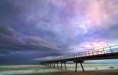 Puente del petroleo. (Ramirez de Gea) Tags: pontdelpetroli badalona sunset atardecer puente mar olas cielo tokinaaf1224mmf4