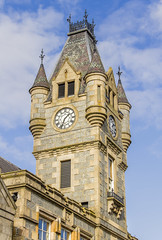 Stewart's Hall Clock Tower (Kev Gregory (General)) Tags: clock tower stewart's hall huntly scotland impressive with four turrets constructed syllavethy granite based design james anderson served town when opened gordon street 1875 reconstructed 1890 after major fire three years before stewart venue concerts entertainment events seat theatre hosts performances partnership aberdeen performing arts kev gregory canon 7d scottish tour scenery scenic historic