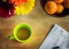 Cuppa and a Crossword (Lisa Bell Jamison) Tags: coffee cuppa puzzle stilllife orange tangerine fruit cup fiesta fiestaware flowers tabletop