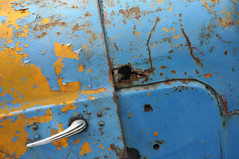 DSC_2149 [ps] - Decorative Rust (Anyhoo) Tags: anyhoo photobyanyhoo cranleighshow cranleigh surrey england uk tractor metal paint painted old worn damaged scratched decay vintage tractors metalwork steel blue yellow fordson rust dented rusty rusting dinged beatenup texture hood bonnet handle chrome sill ridge moulding hole corrosion damage