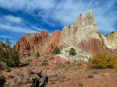 Colorful rock formations. Utah, US (Lena and Igor) Tags: flickrunitedaward utah red rocks blue sky clouds gravel road hills panasonic pointandshoot dmc zs7 nature colorful