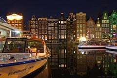 Amsterdam, Damrak      -explore- (Rita Eberle-Wessner) Tags: amsterdam niederlande netherlands damrak wasser water gracht boat boot ship schiff houses holland häuser spiegelung reflection night nacht illumination