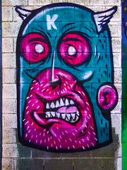 Calling Captain Kris (Steve Taylor (Photography)) Tags: art graffiti mural cartoon blue red mauve purple white black newzealand nz southisland canterbury christchurch city captain k hemet wings teeth grimace kris