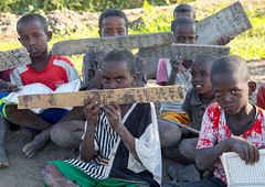 Afar tribe children with wood boards in a coranic school, Afar region, Afambo, Ethiopia (Eric Lafforgue) Tags: afambo afar africa calligraphy children childrenonly colourpicture coran coranicschool danakil day education ethio17234 ethiopia horizontal hornofafrica islam islamic koran kuran learning madrasah madrassa madrassah muslims nomad outdoors pastoralists pupil quran realpeople religion religious school smallgroupofpeople students tribal tribe woodboard worship