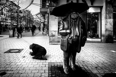 For some....every day is a rainy day. (Mister G.C.) Tags: blackandwhite bw ricoh ricohgr streetphotography urbanphotography candid street shot image photograph people monochrome town city woman lady poor poverty beggar begging statue umbrella hannover towncenter zonefocus zonefocusing snapfocus pointshoot mistergc schwarzweiss strassenfotografie niedersachsen lowersaxony deutschland europe