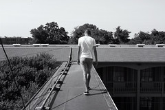 Rooftop Runway (Fire At Will [Photography]) Tags: black white bw virginia va fire will photography fw abandoned urbex urban exploring exploration explore urbexing roof rooftop runway friend man male person people hotel motel petersburg photo