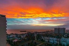Sunset last night 2 Feb 2017, over Brighton and Hove, England (michaelasss) Tags: brighton hove england sundown orangesky beach sea twilight evening ocean pier cityscape rooftops buildings houses uk highrise towerblocks arcitecture