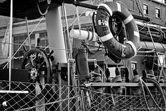 Spirit of Buffalo Steering Wheel - Canalside - Buffalo, NY (DTB_7951) (masinka) Tags: summer bw ny newyork boat buffalo downtown ship rope steeringwheel canalside spiritofbuffalo etbtsy