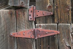 History's hinges (Rocky Pix) Tags: county wood red mountain creek rockies colorado pix paint doors rocky boulder lodge watershed exit 60mm siding nikkor f11 stables hinges stvrain ferncliff rockypix stvraincreek normalzoom 160thsec pointopines monopodheld wmichelkiteley 2470mmf28f28g stvrainriverbasin historyshinges