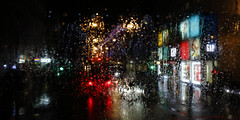 _C0A7610REWS Rainy Window II, © Jon Perry, 1-1-17 (Jon Perry - Enlightenshade) Tags: jonperry enlightenshade arranginglightcom rain rainy window raindrops drops abstract lights colouredlights coloredlights oxfordstreet london fromthebus januaryfirst firstofjanuary newyearsday newyear 1117 20170101