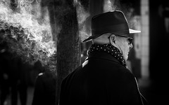 The mystery of the hat man (hector_cbs) Tags: mystery hat man black smoke people monochrome street social candid