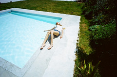 She is there (Alice Korotaeva) Tags: japan nature model girl legs beauty beautiful pool swimmingpool grass loan bright sunny summer lazy fashion filmphotography film film35 35mm lomography grain bessa bessal analog rangefinder voigtlander voigtlander15 ultrawide wideangle water blue chiba travel relax rest kodak portra portra400