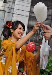 (Danburg Murmur) Tags: woman japan bottle robe hiroshima powerlines wires plasticbag yukata  cottoncandy nippon nihon  plasticbottle    nihonkoku nipponkoku  toukasanfestival