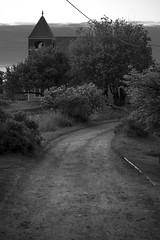 Monhegan Church, Main Street, dusk,  Monhegan, Maine, Nikon D40, nikon nikkor 55mm f-3.5, 6.29.15 (steve aimone) Tags: blackandwhite monochrome architecture landscape mainstreet dusk maine monochromatic powerline dirtroad monhegan roadway latelight monheganisland primelens nikond40 nikonprime monheganchurch nikonnikkor55mmf35