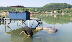 Sunken paddle boat in Lake Pécs (zsonemes) Tags: travel summer sun lake reflection travelling abandoned tourism nature pen reflections bench lite boat europe hungary quiet peace young paddle peaceful sunny olympus calm hills traveller summertime sunken amateur hilly pécs orfű zd epl5