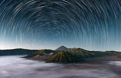 Sleeping Giants || Mt Bromo Indonesia (dick18incheslong1) Tags: 0landscapesandatmosphere 0portfolio 0portfolioexpanded d800 penanjakan semeru tenggermassif asia bluehour bromo caldera clouds fog indonesia landscape longexposure mountains night portfolio portfolio2 startrails stars travel wideangle