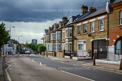 """Plough Road Scene - London, England, 2016 (Photographie Alexi """"Alvin"""" Dagher Photography) Tags: 2016 architecture audicar block british chimneys cityscape cityskape curved curvy cyclelanelookbothways darkclouds daytime england facades fences frontfacade greatbritain horizontal houses landscape leadinglines london looking old outdoor ploughrd road scene scenery scenic signs street summer thick traditional trees uk vanishingpoint windows zebracrossing ©alexidagher clapham junction"""
