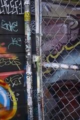 DSC1351a6000  San Francisco  ©2016 Paul Light (Paul Light) Tags: california missiondistrict sanfrancisco city colorful fence graffiti stickers urban wall wallart