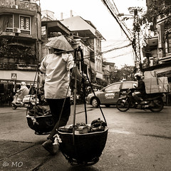 Crossing the street of Hanoï (mathieuo1) Tags: hanoi vietnam crossing people street capital traffic blackandwhite sepia streetphotography seller road car nikon d5 zoom dlsr asia dynamic mathieuo travel close culture discover moving beauty wideangle