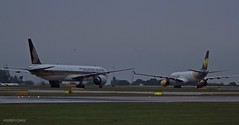 _MG_0004 Singapore airlines and thomas cook (M0JRA) Tags: rain weather manchester airport singapore thomas cook planes airlines storms