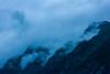 Dans la brume... (Melvinia_) Tags: sky mountain alps nature weather fog clouds montagne alpes canon dark skyscape landscape 50mm nationalpark europe mood paca ciel sombre nuages paysage aftertherain brume ambiance pelvoux hautesalpes ailefroide écrins aprèslapluie parcnational sommets canoneos450d digitalrebelxsi