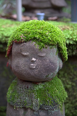 Jizo statue with mossy head