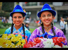 Two Girls at Mama Negra Festival in Quito, Ecuador (Sam Antonio Photography) Tags: ecuador quito portrait mamanegra parade smiles street girls samantoniophotography travel southamerica photography inarow ethnicity quechaindian horizontal traditionalclothing colorimage indigenousculture ecuadorianculture people ethnic female women capitalcities latinamerica blue dancing carnival traditionalfestival nationalclothes textile plaza party smile yellow colors costumes culture folklore festival dancers dress