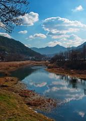 Beautiful blue sky and clouds in January along Jeonju River (HigginsKorea) Tags: fujix jeonju river water cloudy landscape xt1 fujixt1 beauty kitlens refelection southkorea scenic bluesky