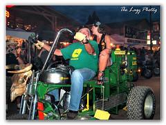 Aug 2005 - John Deere in Sturgis SD (lazy_photog) Tags: lazy photog elliott photography sturgis motorcycle rally south dakota biker babes bikini bike wash john deere tractor green yellow