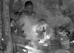 Black Hephaestus (vittorio vida) Tags: hephaestus black bn bw fire blacsmith smoke africa ethiopia children dad father son work travel people portrait