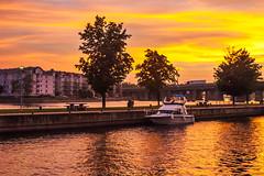 Sunset on the River (FotoMemi) Tags: nikond70 scenery flickr d70 montreal nikkor nikondx dx stlawrence canada river sunset golden goldenhour red orange dusk boat