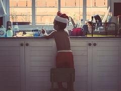 A summer santa claus. (Pablin79) Tags: portrait people window christmas child chair play kid childhood indoor xmas daylight inside argentina santa vicente indoors navidad misiones vini posadas